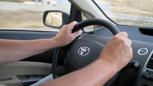 Driving with hands on 10-2 position on steering wheel at 80 miles per out.